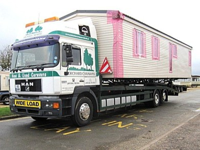 Photo of Caravan transport vehicle loaded and ready to go.