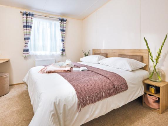 Brochure picture of a 2018 ABI Summer Breeze 28 x 10 2 bedroom holiday caravan.
