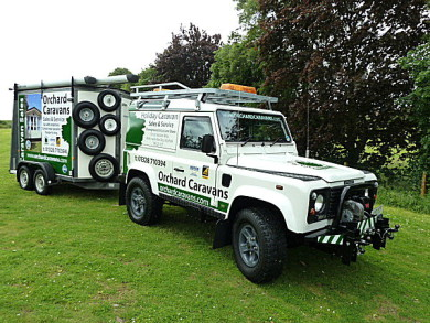 Photo Land rover and trailer used by the siting team at Orchard Caravans
